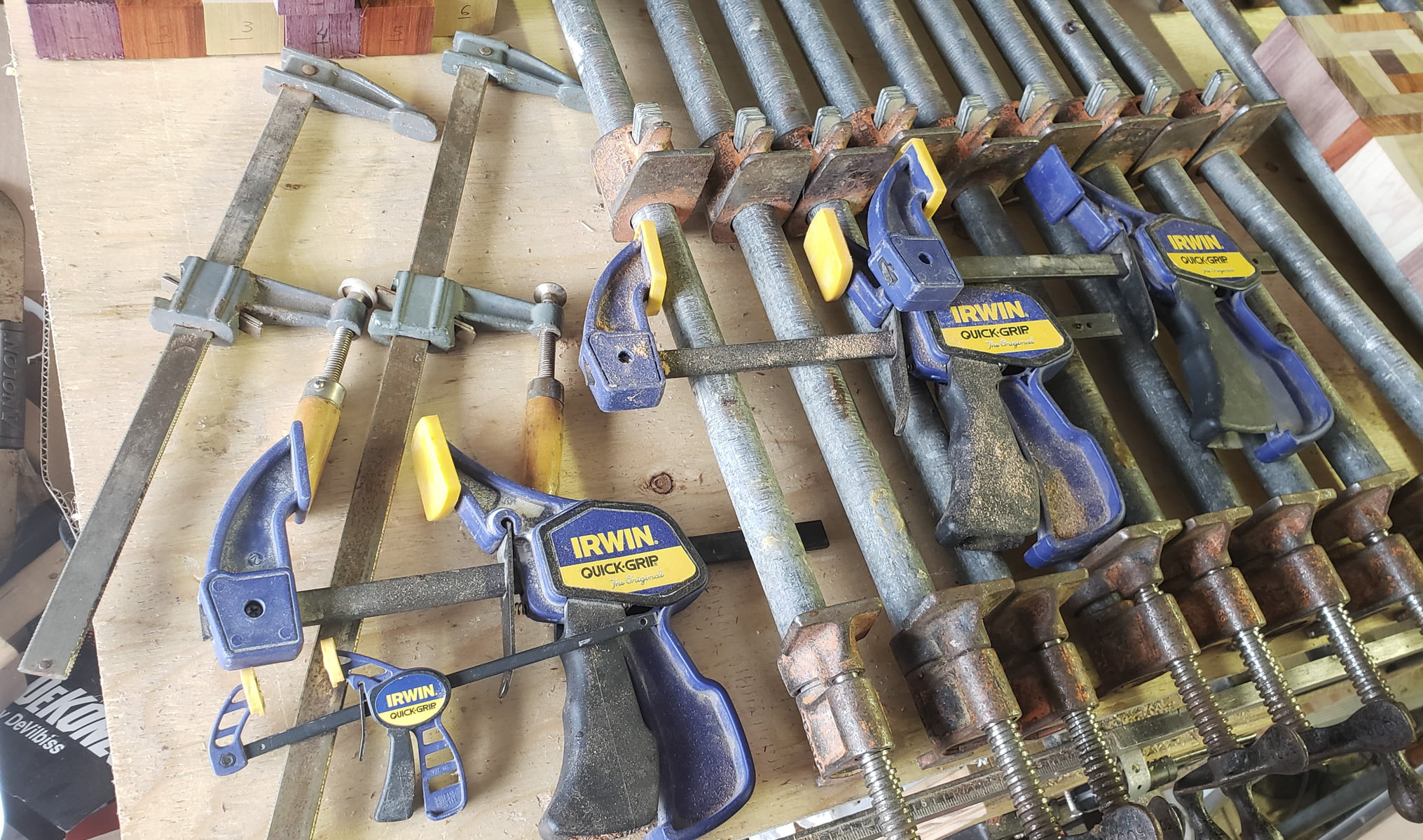 Various clamps spread on a table.