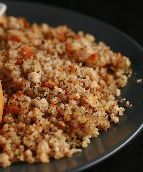 Close up photo of a plate of dressing - seasoned and buttered bread crumbs.