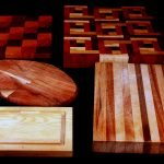 A selection of cutting boards - 2 shaped like maple leaves, one oblong, one striped, and two fancier and multicoloured.