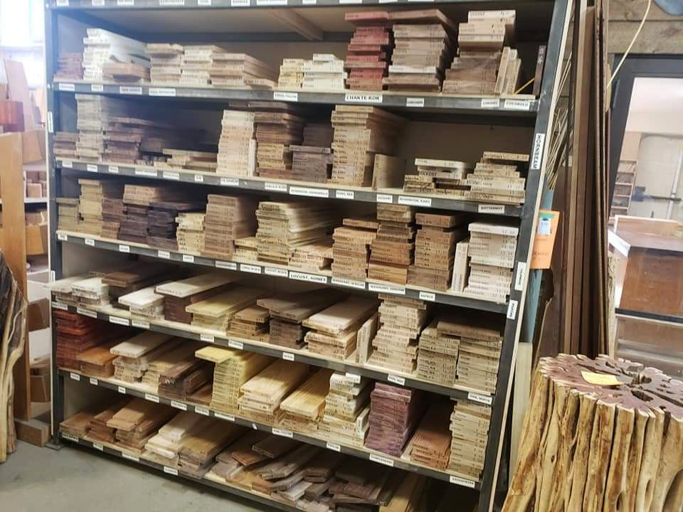 Shelves full of colourful wood, perfect for custom homemade cutting boards.