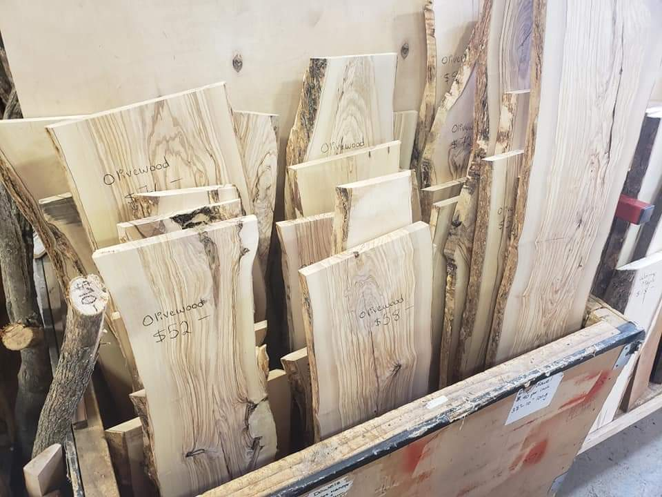 A bin of large planks of wood.