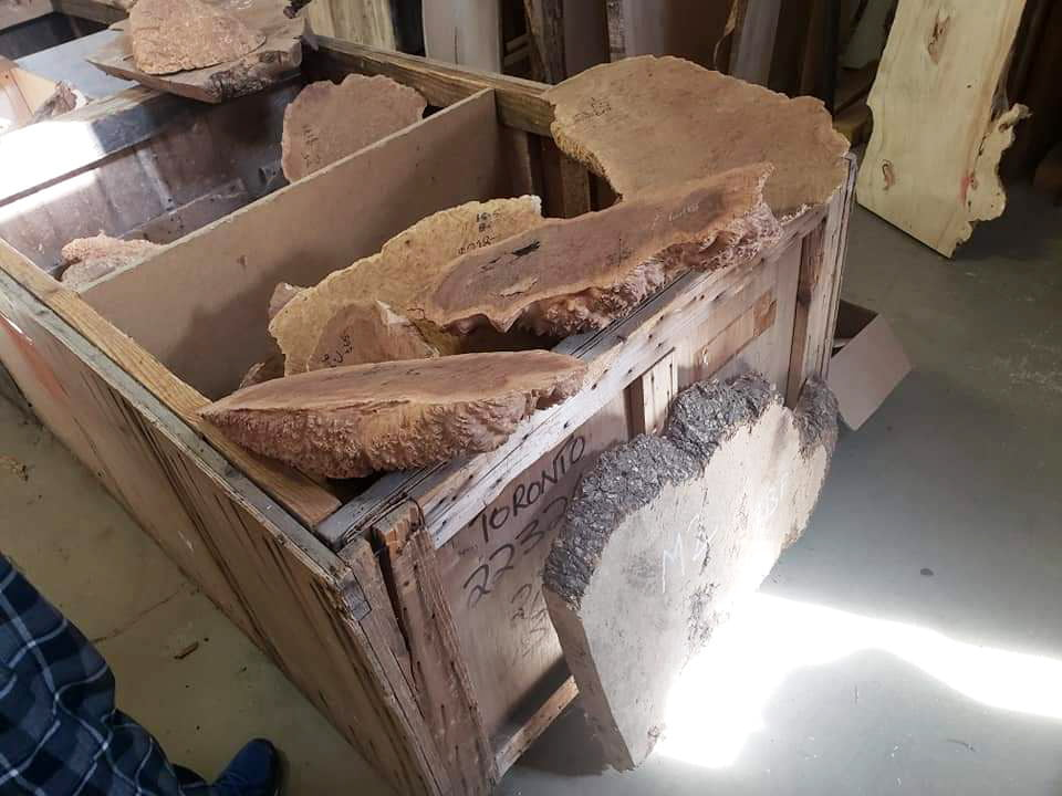A bin of large slices of wood.