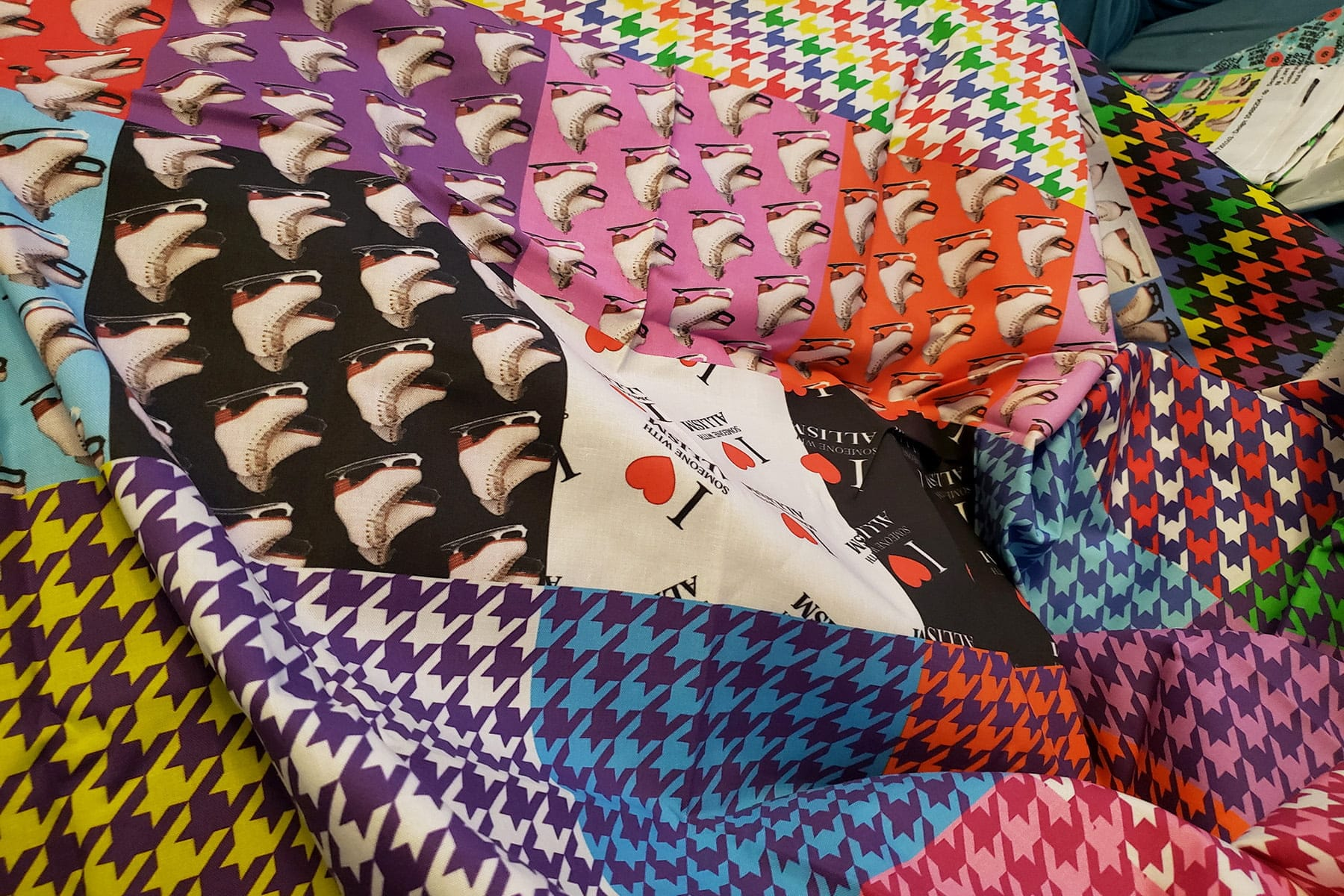 Photo of a selection of print fabrics, draped in a pile