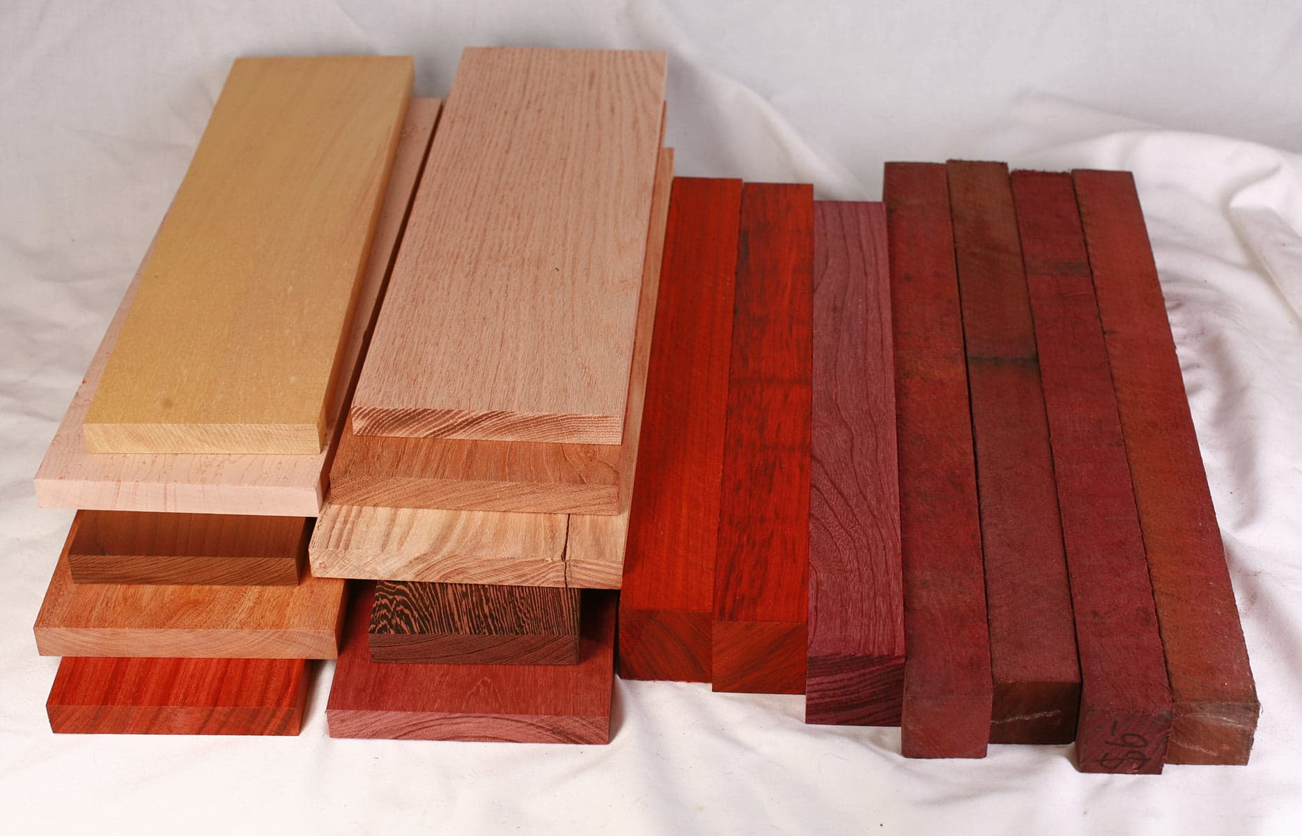 A stack of brightly coloured wood boards