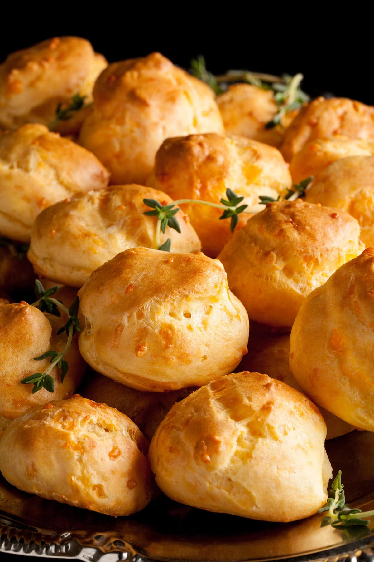 Close up view of a plate of gluten-free gougères - cheese puffs