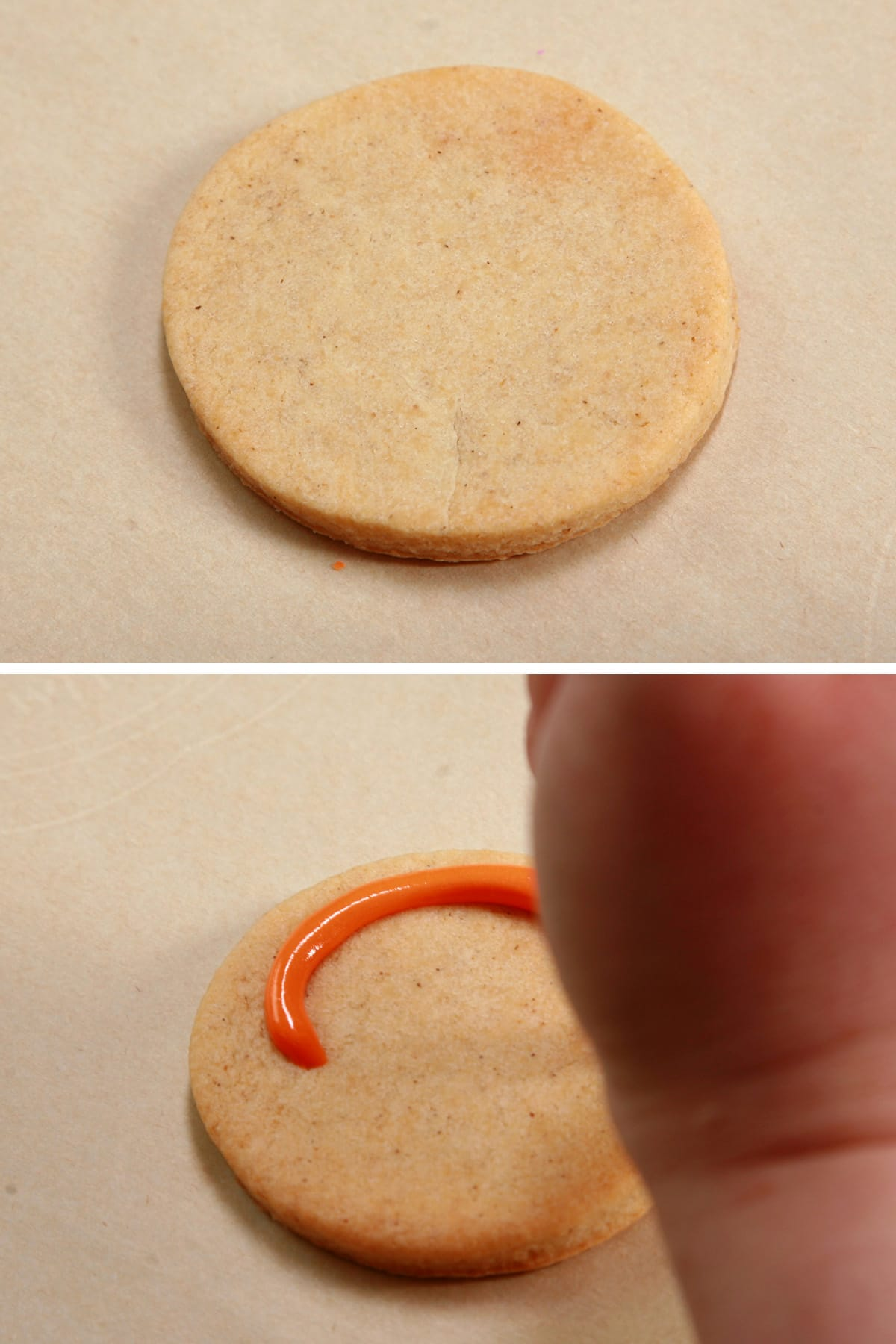 A hand in the foreground is applying orange frosting to a cookie.