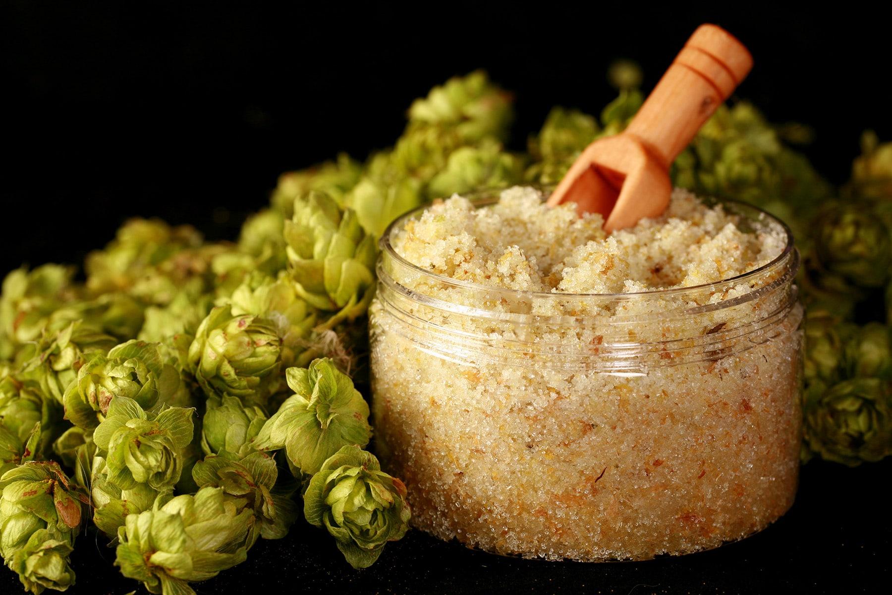 A close up photo of a jar of hopoed salt scrub.
