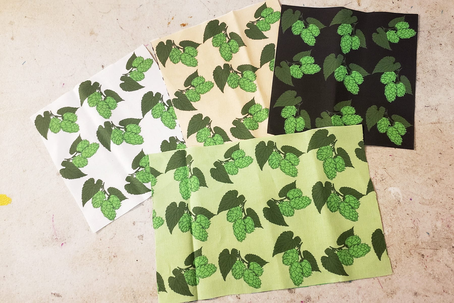 Photo of a selection of fabrics featuring hops.