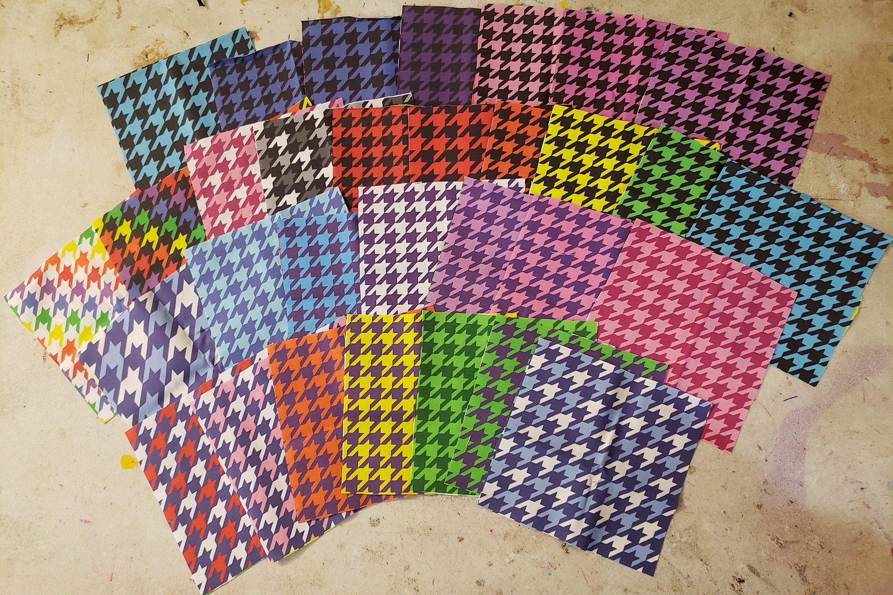 Photo of a selection of fabrics featuring various colourful houndstooth designs