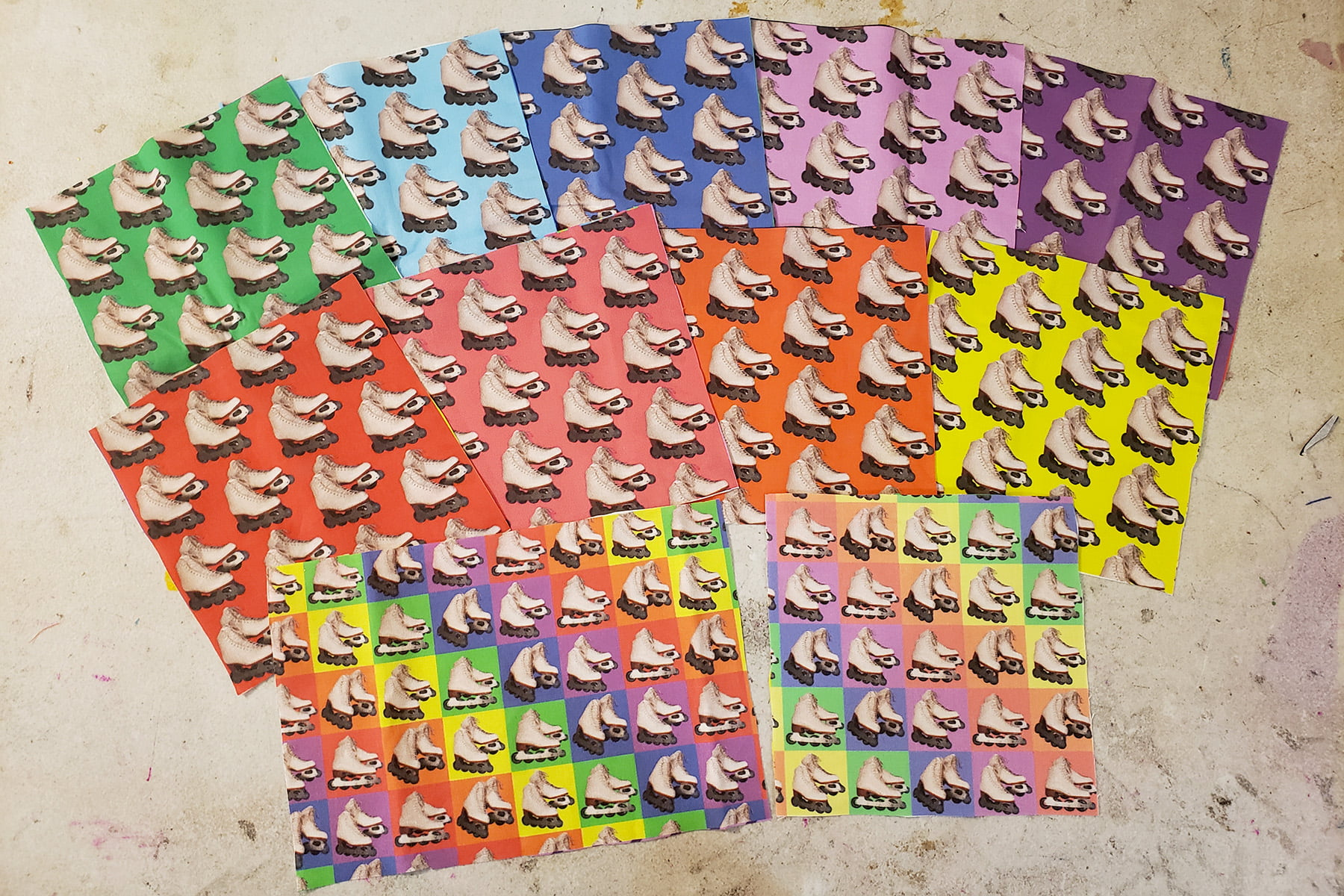 Photo of a selection of fabrics featuring inline figure skates on a variety of colourful backgrounds.
