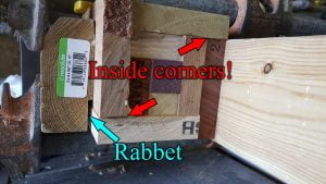 """The end of a rectangular block made from several pieces of different colored wood is seen. Two arrows point to locations, labelled """"Inside Corners"""". Another arrow points to a notch in a board, labelled """"Rabbet""""."""