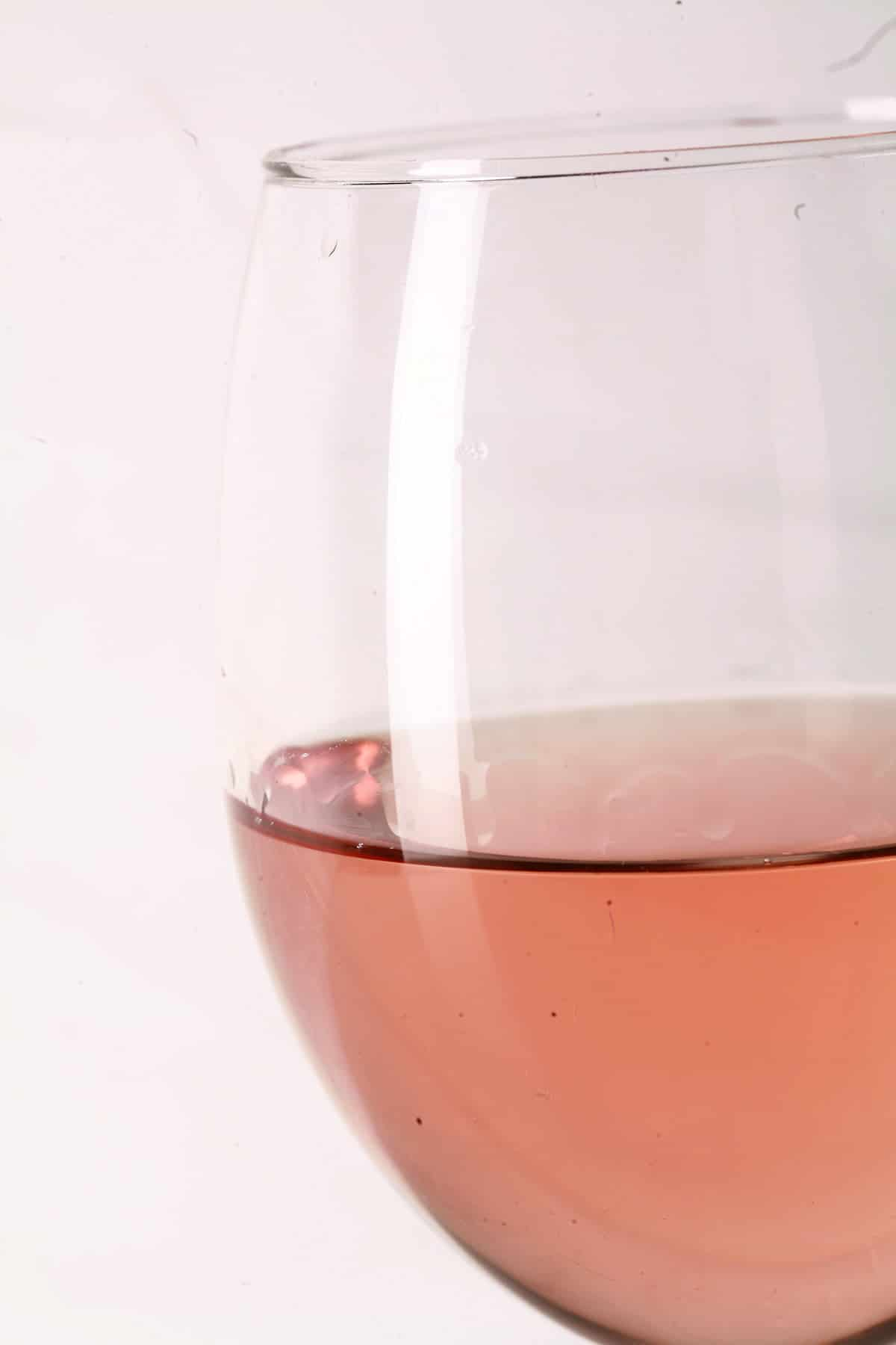 Close up view of a glass of mango strawberry wine.