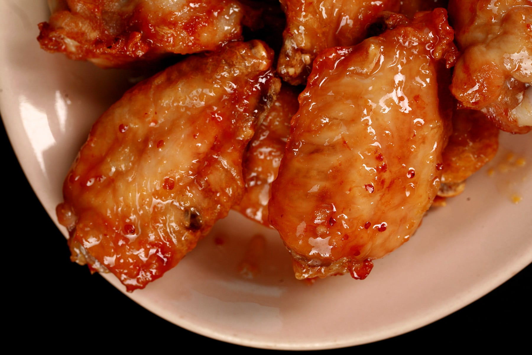 A small plate of maple dijon glazed wings.