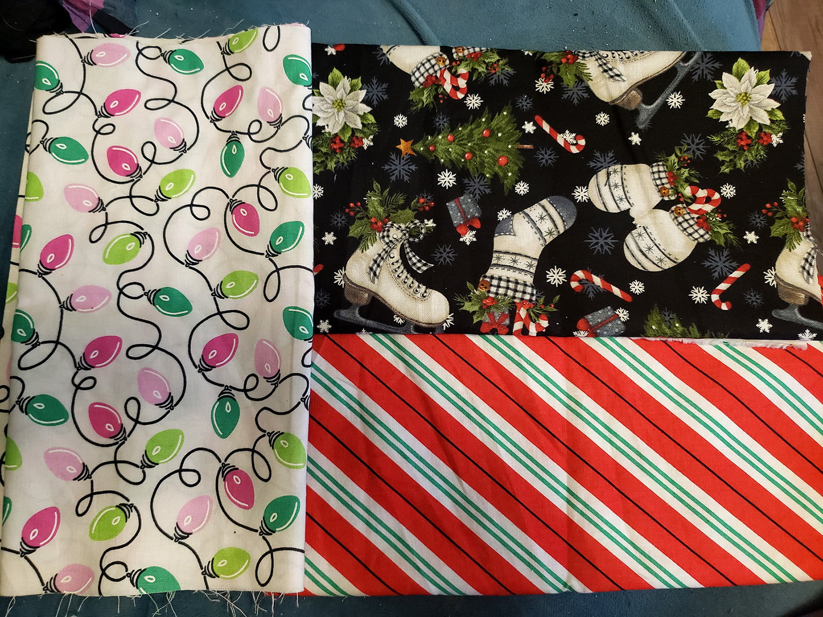 3 pieces of holiday print fabric, laid out on a flat surface.