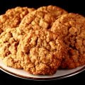 Close up photo of a plate of oatmeal cookies with visible butterscotch chips