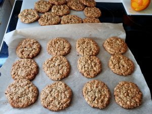 Freshly baked cookies on parchment paper, cooking on a stovetop