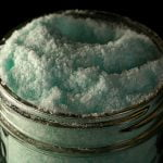 Close up photo of light blue-green coloured peppermint-eucalyptus bath salt