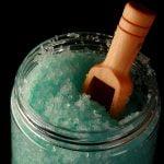 Close up photo of light blue-green coloured peppermint-eucalyptus salt scrub.