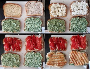 A progression of sandwich assembly photos. In the first quadrant, the lower part of the sandwiches are spread with pesto mayo. In the next square, goat cheese is added to the top slices. In the 3rd square, roasted red pepper slices are added on top o the goat cheese, and in the final quadrant a chicken breast has been added on top of the pesto maypnnaise.
