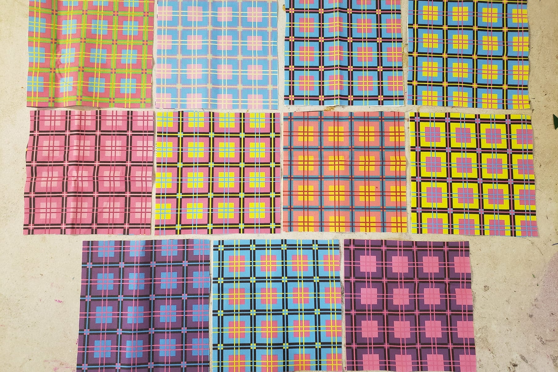 Photo of a selection of fabrics featuring a variety of colourful plaid designs.
