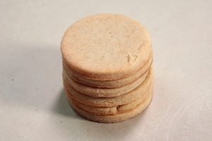 Stack of round, un-decorated cookies