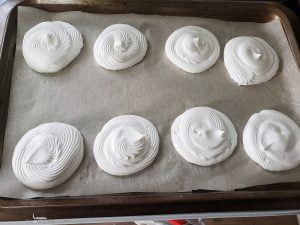 8 small meringues, piped onto a parchment lined baking sheet.