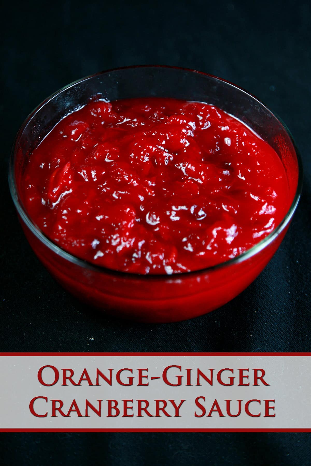 Close up view of a bowl of chunky cranberry sauce.