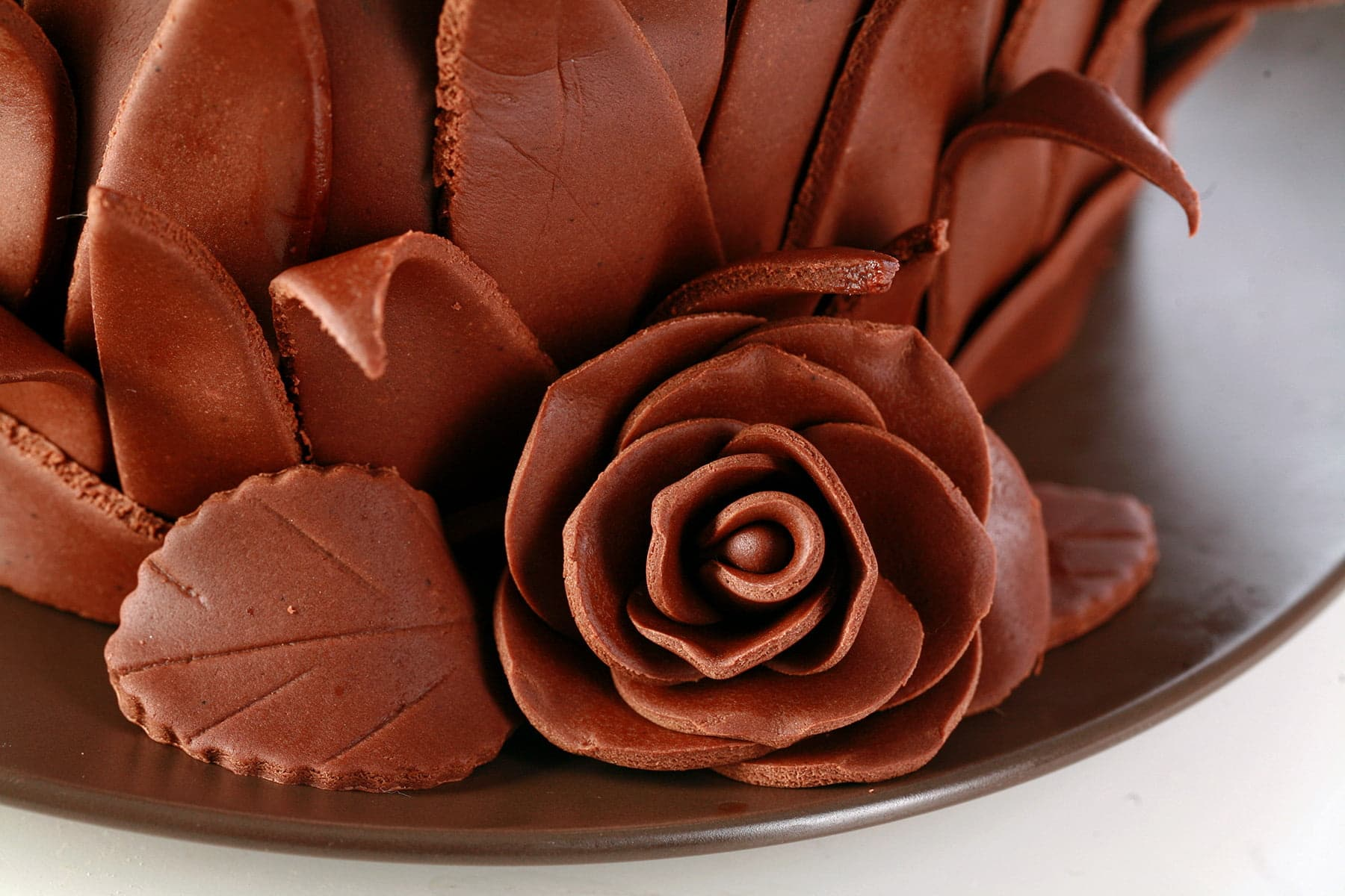 A close up view of a rose made from chocolate fondant.