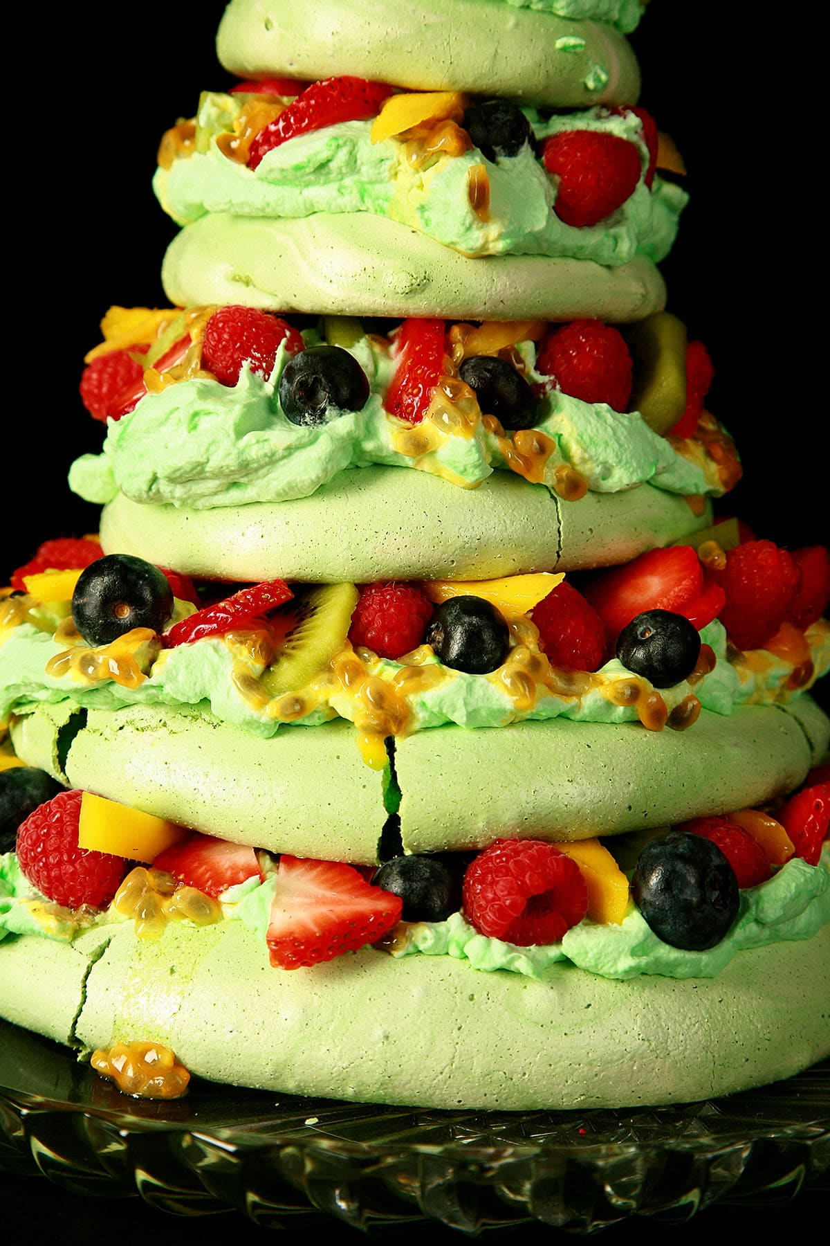 Side view of a 5 tier Pavlova, styled to look like a Christmas Tree.