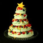 A 5 tier Christmas Tree Pavlova, topped with a star shaped slice of mango