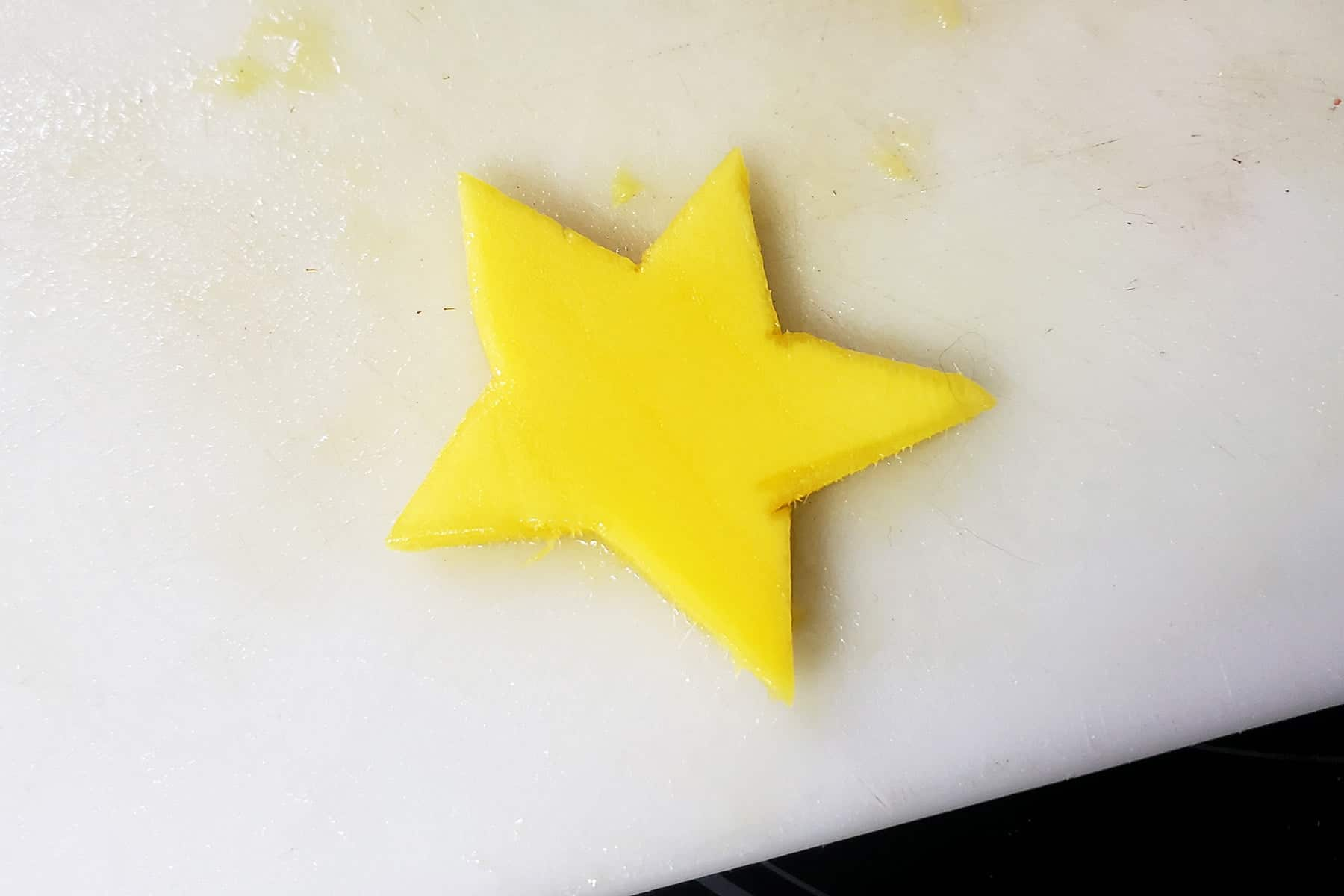 A slice of mango has been cut to look like a star.