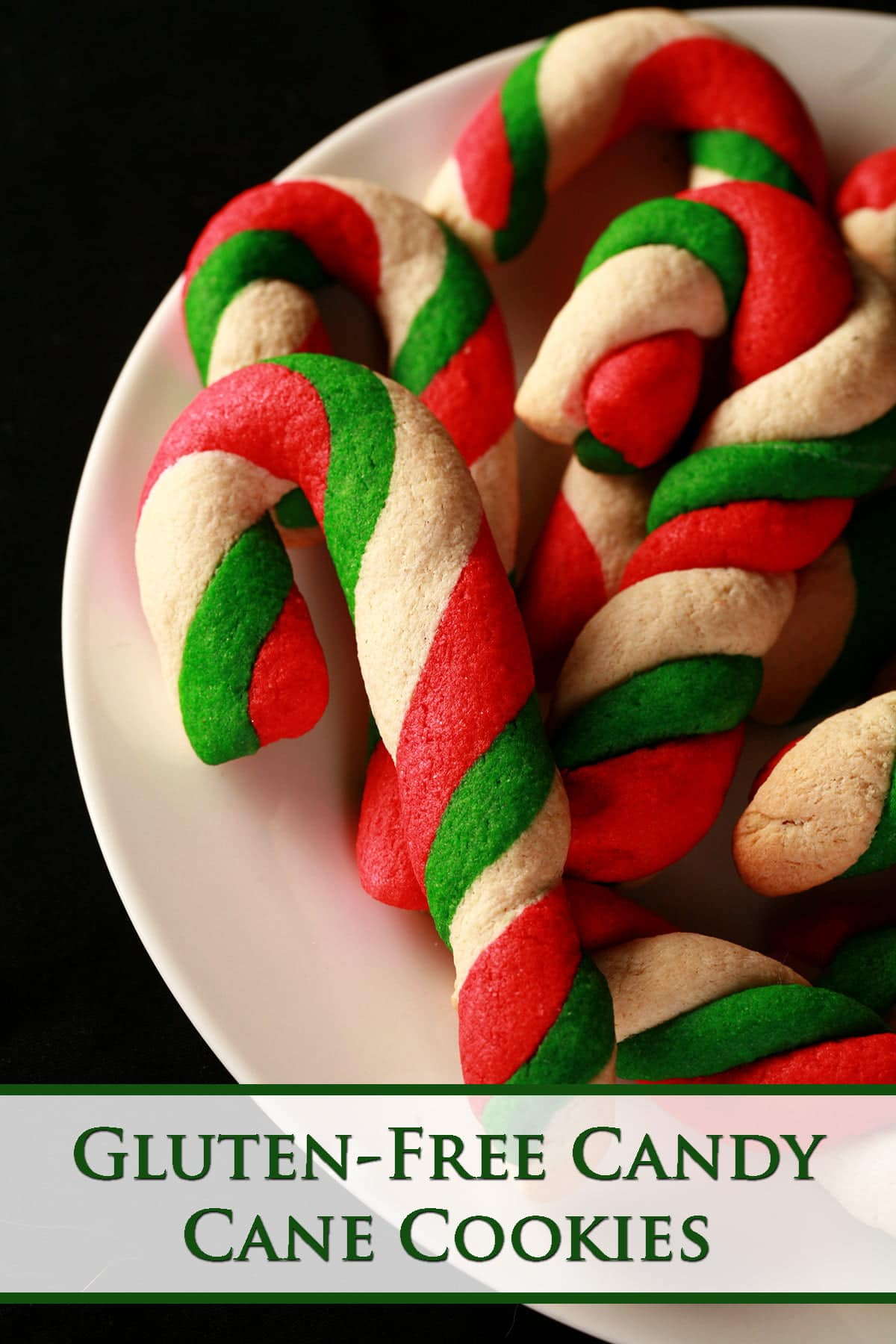 Gluten-Free Candy Cane cookies - candy cane shaped cookies, made from lengths of red, green, and white twisted dough - on a plate.