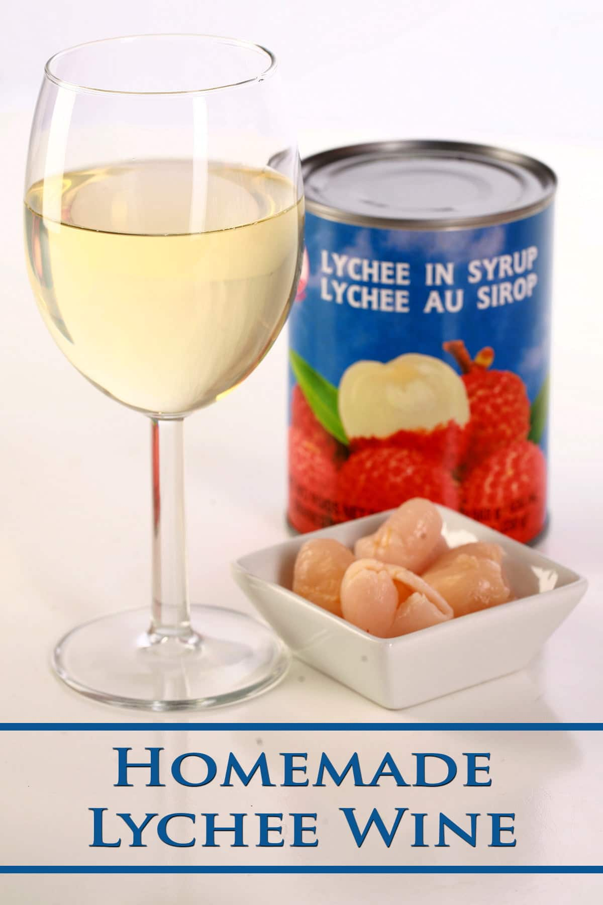 A glass of white wine is shown next to a small bowl of lychee fruit, and a can of lychees.