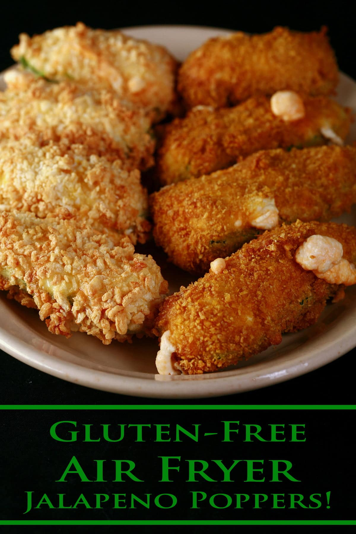 A small ivory colour plate holds two different types of gluten-free jalapeno poppers. They have been cooked in an air fryer.