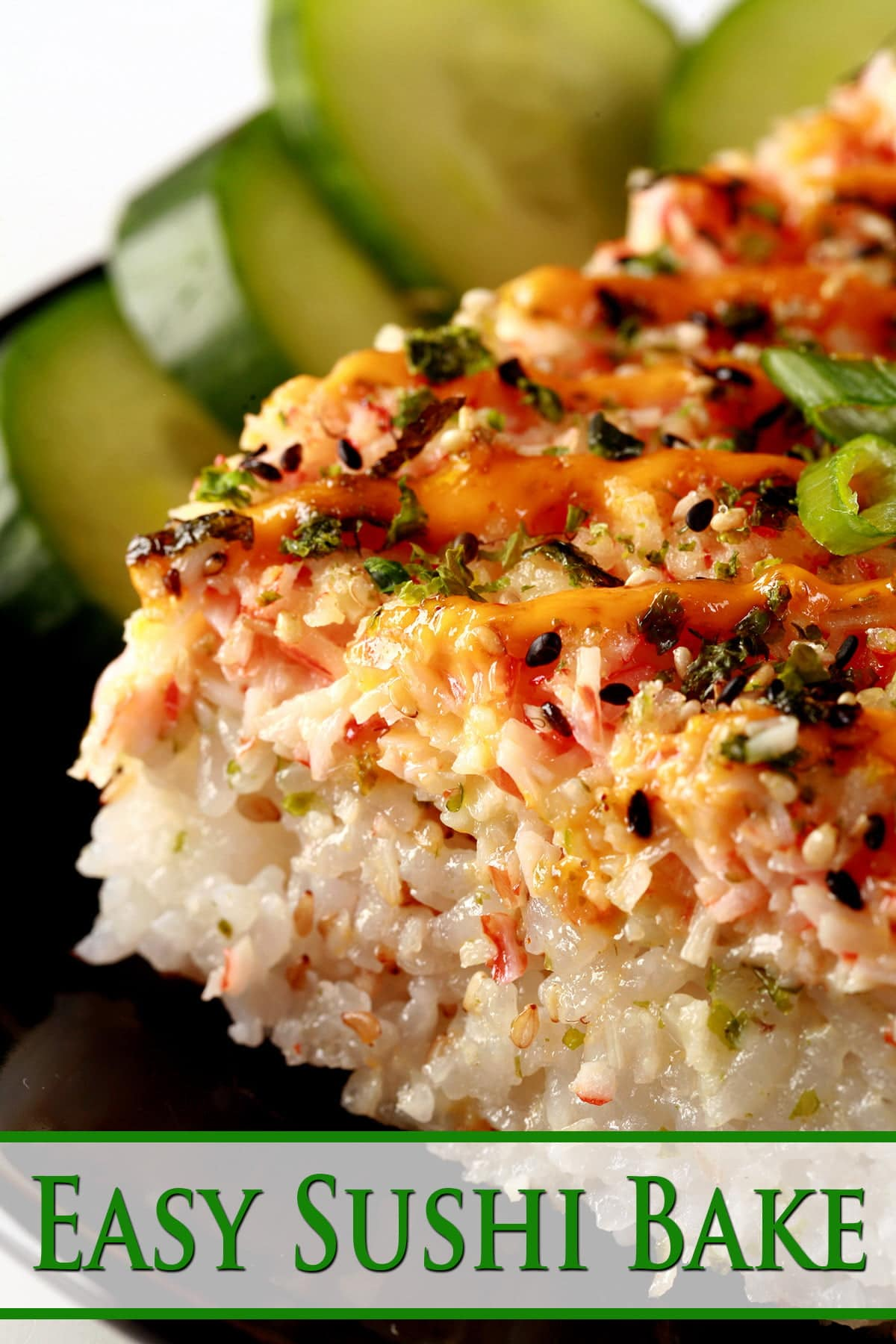 A close up view of a square serving of sushi casserole - sushi rice, furikake, and a spicy imitation crab topping.