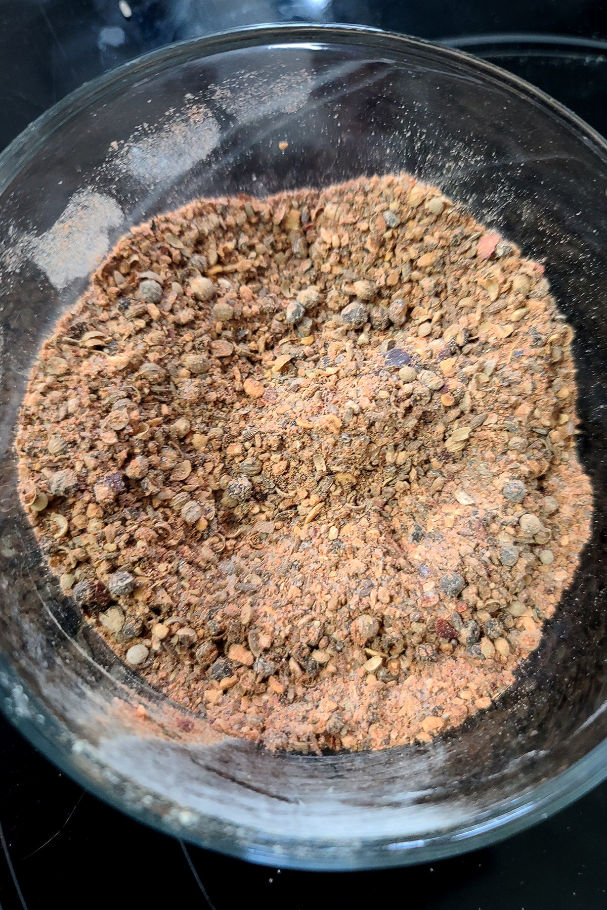 A glass bowl full of freshly ground Montreal Steak Spice.