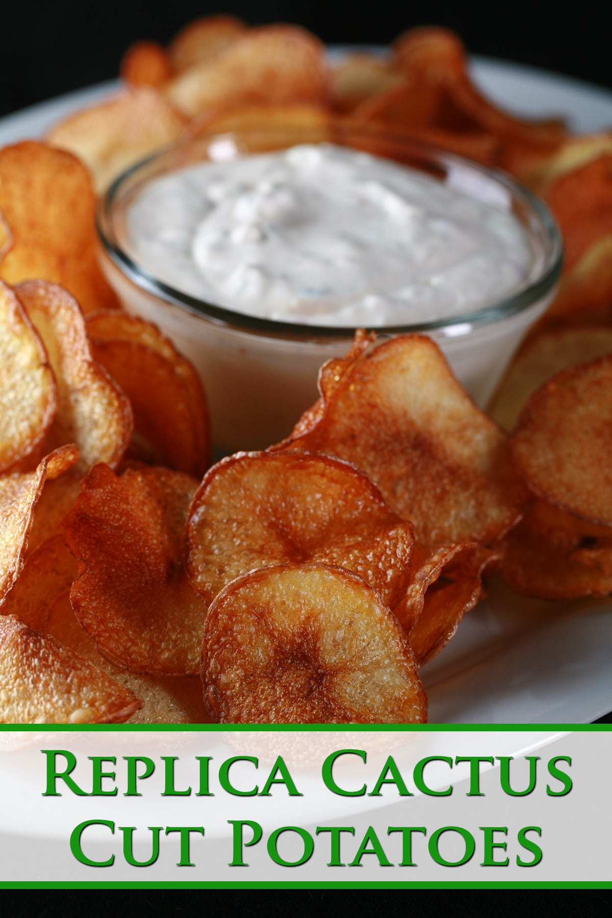 A large platter of fried potato slices, with a bowl of cactus dip. Based on a Boston Pizza appetizer. Green text overlay says Cactus Cut Potatoes