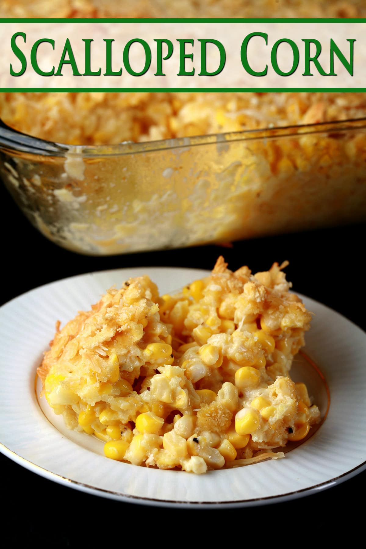 A serving of scalloped corn - fresh sweet corn, cheese, crackers, and more - on a small white plate.  The pan of casserole it was served from sits behind the plate.
