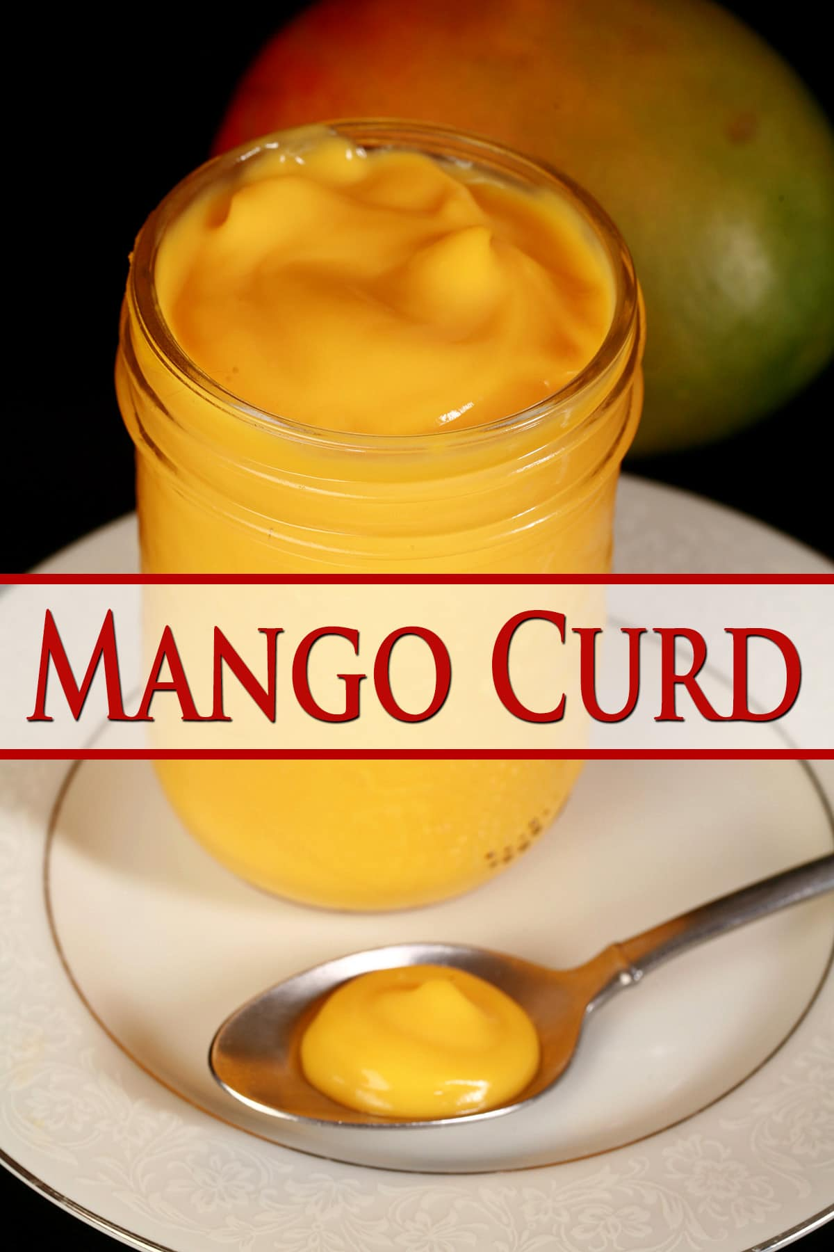 A jar of mango curd along with a spoon of the curd on a white plate.