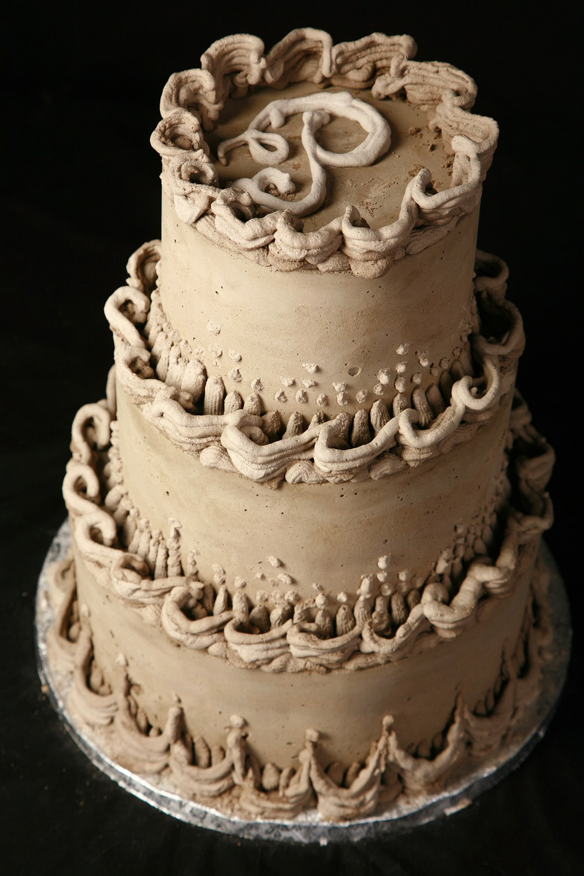 A 3 tiered wedding cake - Lambeth style - completely made from cement.