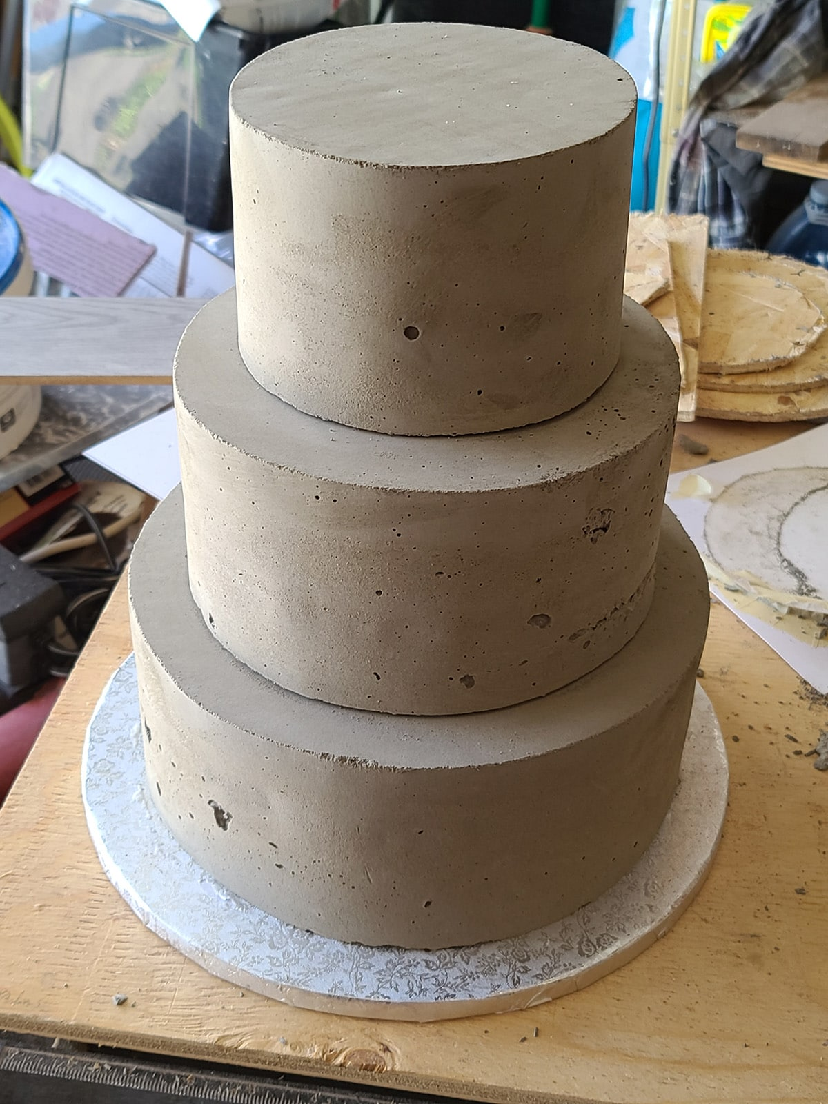 A 3 tiered plain wedding cake made of cement.