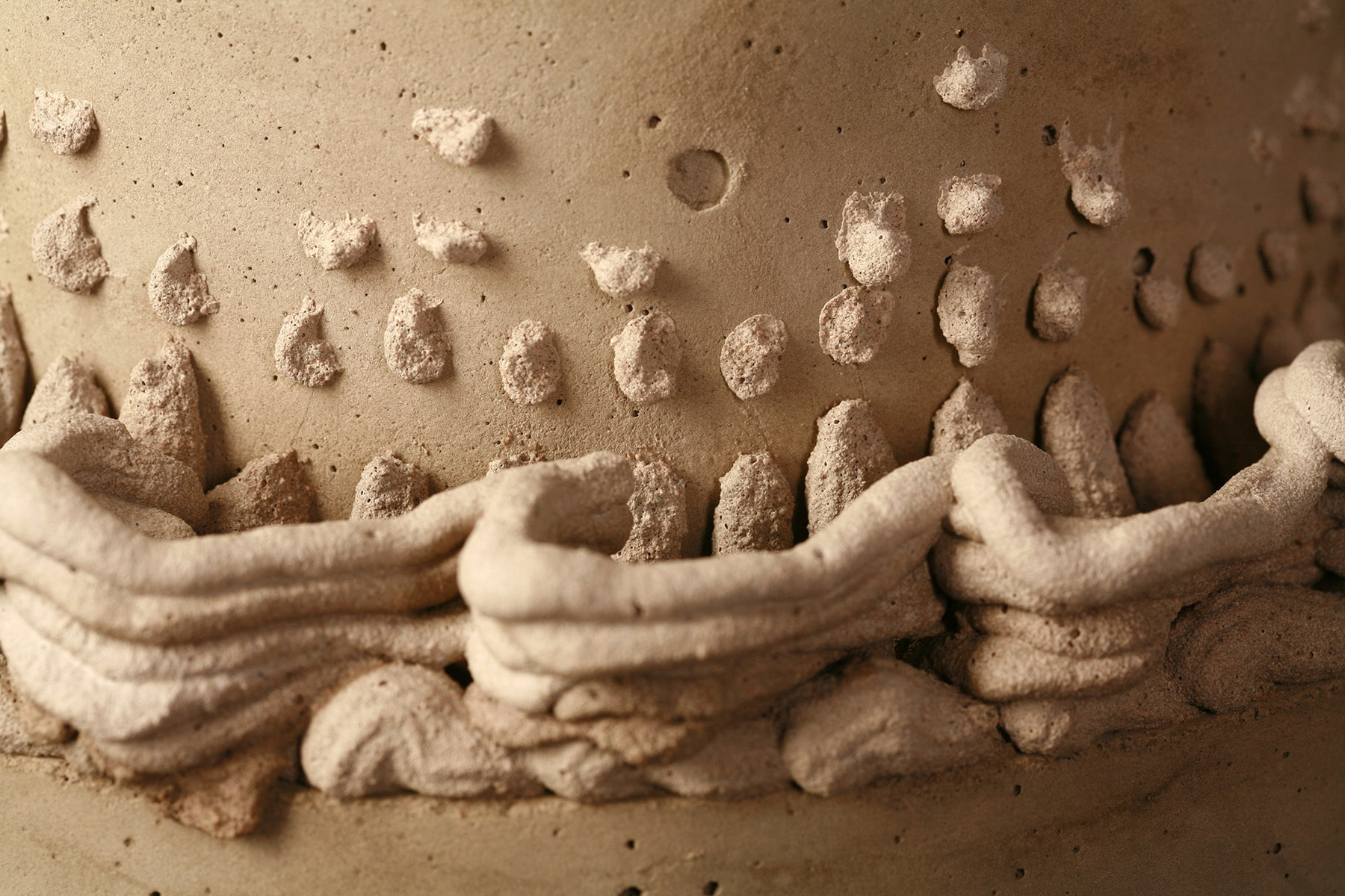 A close up view of Lambeth style cake piping, made in cement.