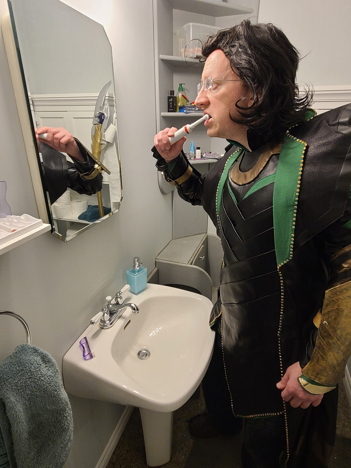 Loki brushing his teeth with the water off.