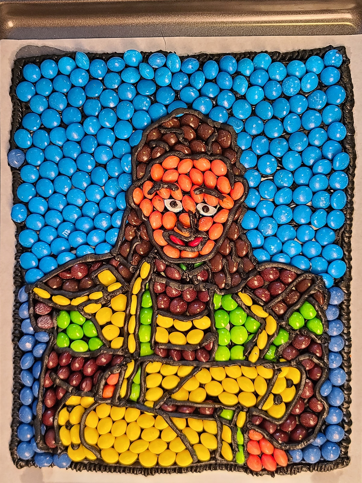 A picture of Loki, made from Skittles & M&Ms.