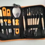 A set of pumpkin carving tools, in a zippered case.