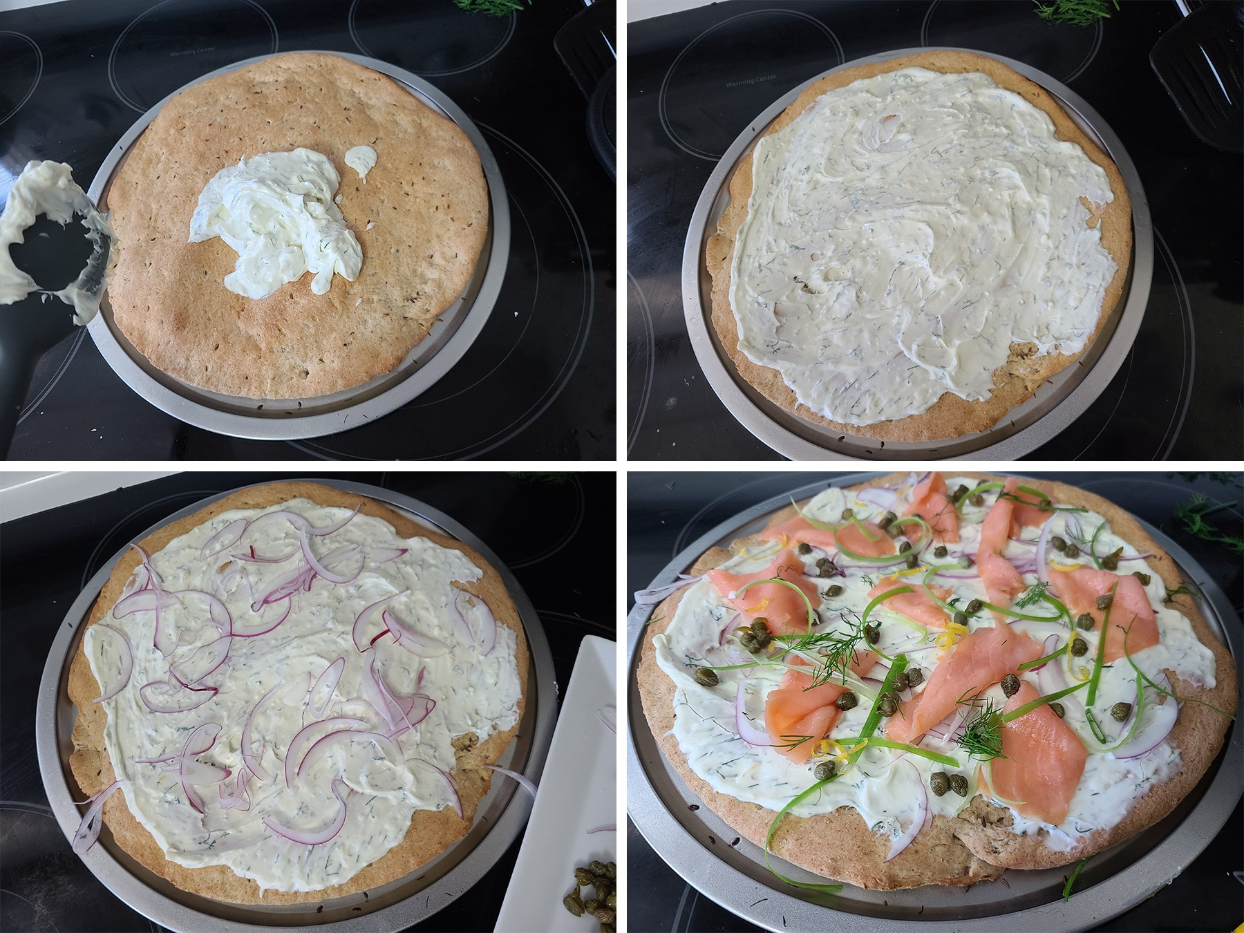 Cream cheese being spread on the rye pizza crust and topped with smoked salmon.