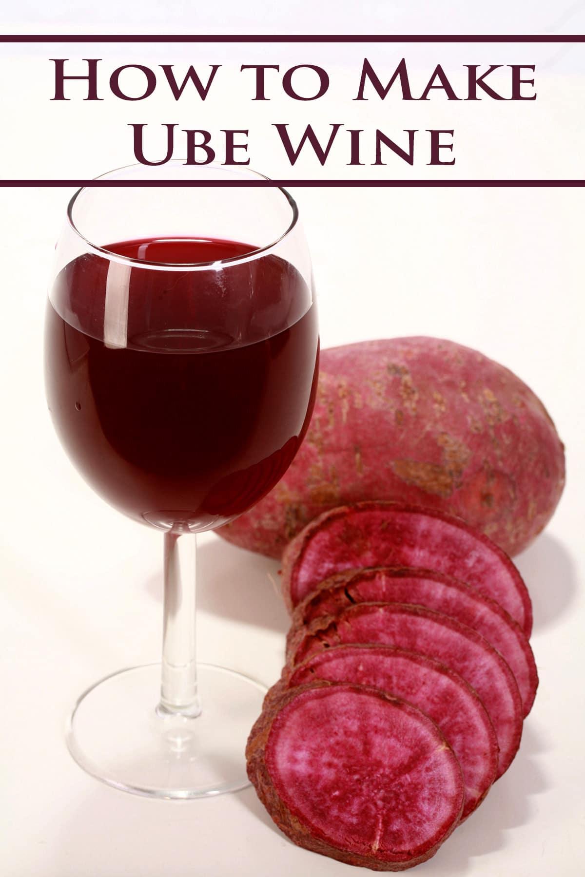 A wine glass with deep purple ube wine, next to a sliced up ube - purple sweet potato.