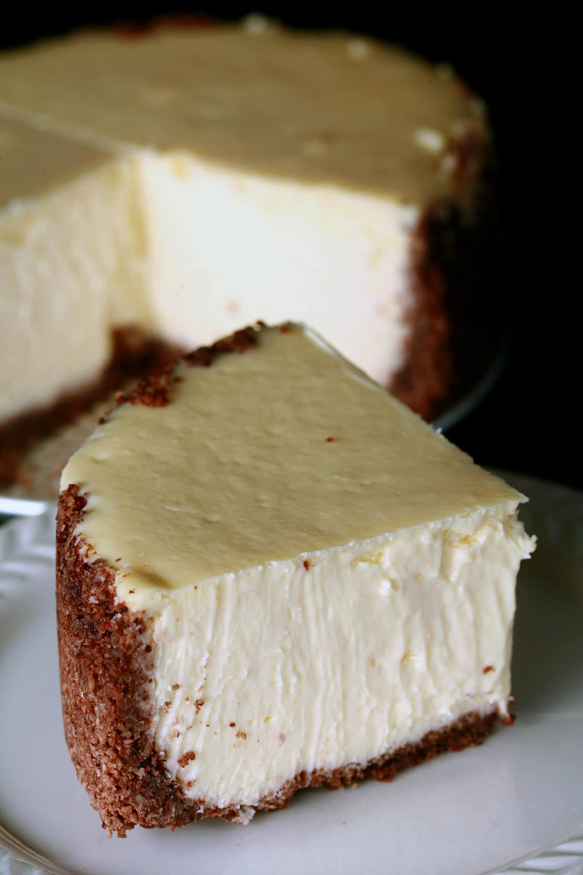 A close up view of a creamy 6 inch vanilla cheesecake.