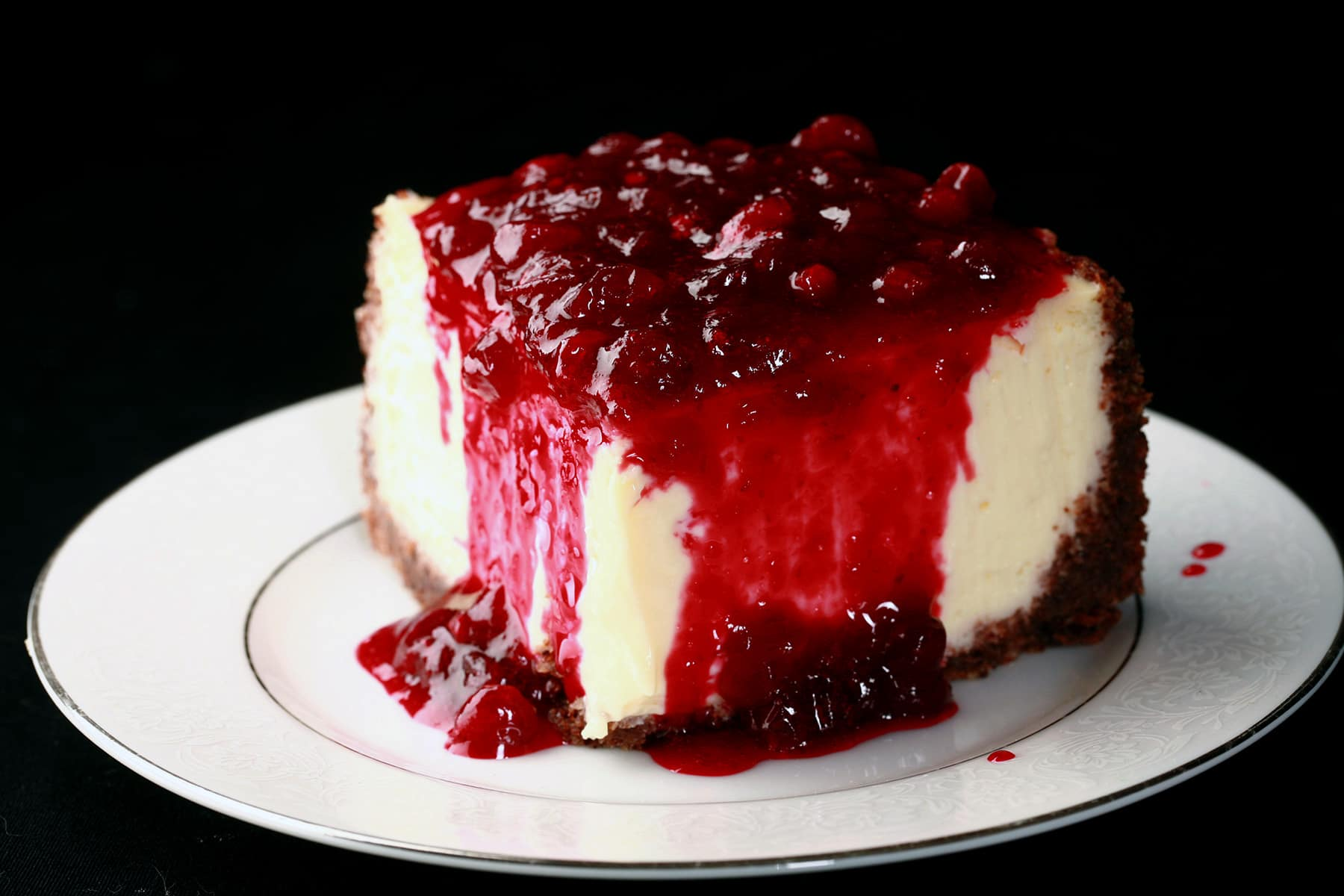 A close up view of a slice of partridgeberry cheesecake.