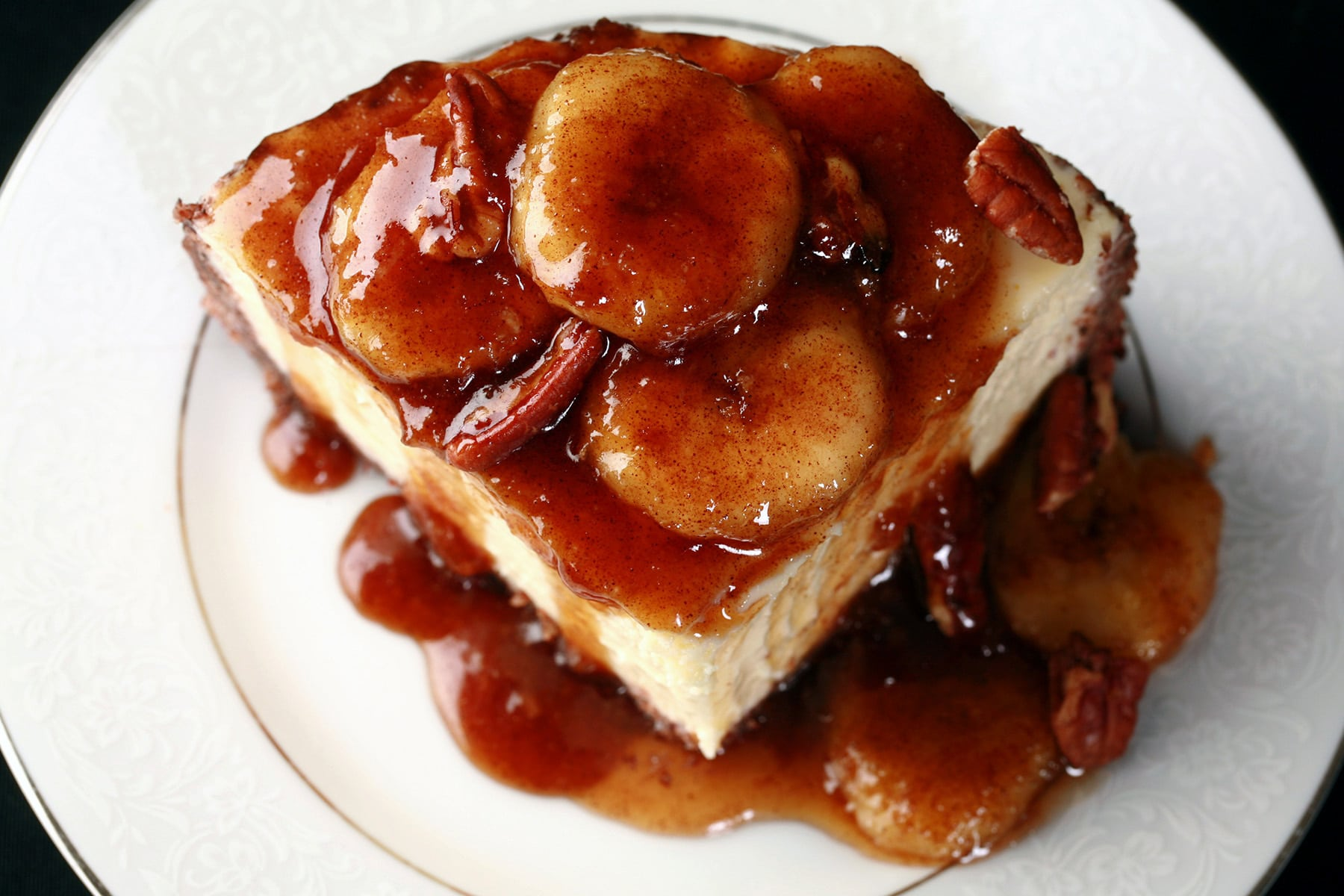 A close up view of a slice of Bananas Foster cheesecake.